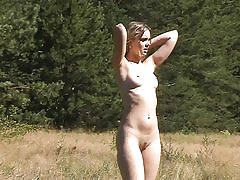Outdoor youthfull honey swims and poses nude