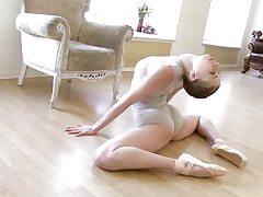 Gymnastic youthfull shorthaired stunner demonstrates abilities